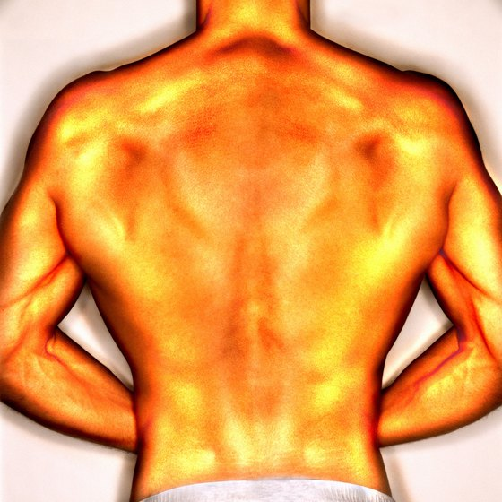 The lats extend from just under the arms to the middle of the back.
