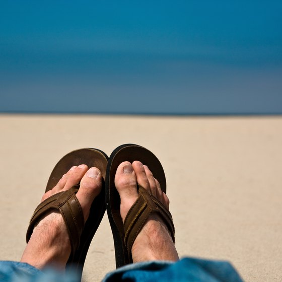 A pair of sturdy flip-flops keeps feet cool but protected from hot sand.