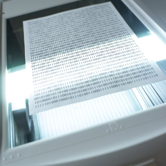 Dust on scanner glass causes streaks on scanned documents.