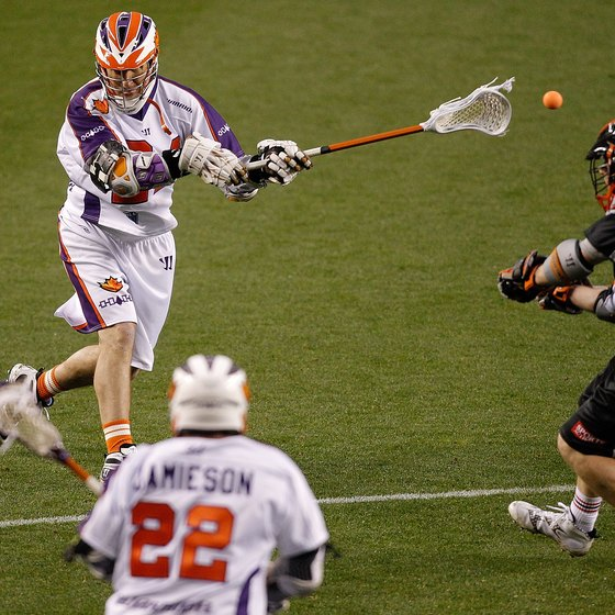 Hamilton's John Grant, top left, shoots from just beyond the two-point arc in a 2011 Major League Lacrosse game at Denver.