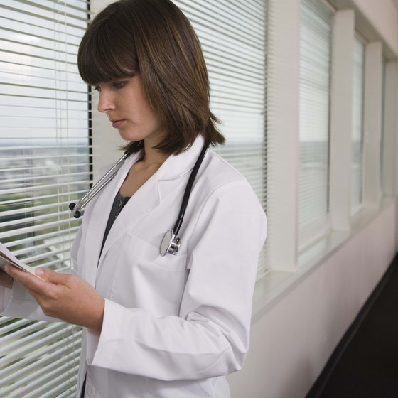 Doctor looking at results on clipboard