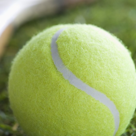 A simple tennis ball can help you build hand and finger strength.