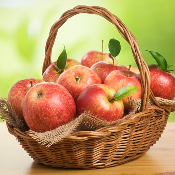 Basket of fresh apples on a table