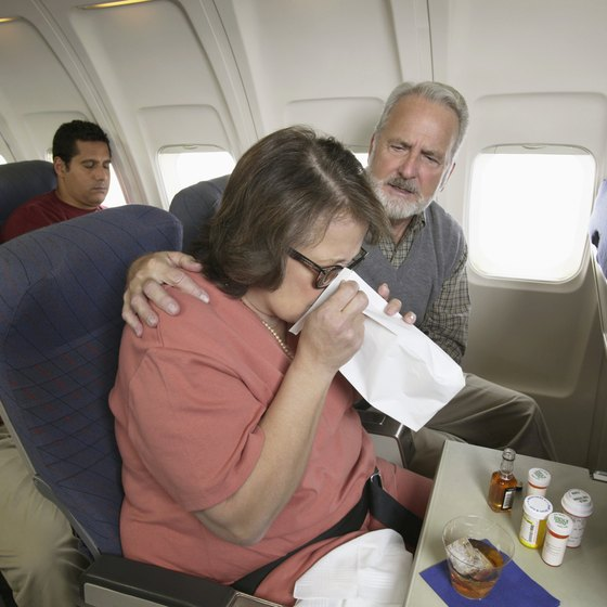 If you get sick on your flight, use the provided bag or go to the washroom.