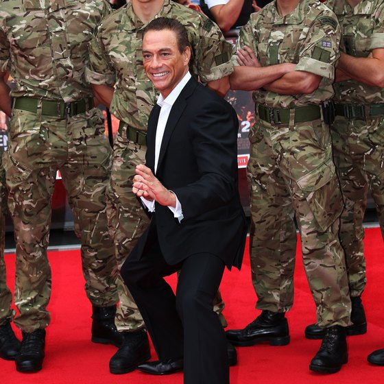 "Van Damme poses at the film premiere of ""Expendables 2."""