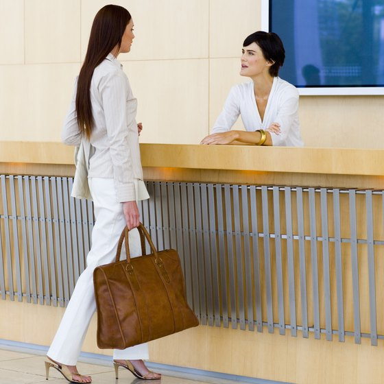 Hiring a receptionist is considered an overhead cost.