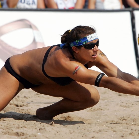 Misty May-Treanor digs the ball, a supreme test of agility.