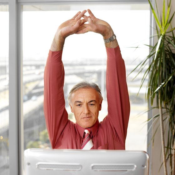 You can still get in a good stretch, even while sitting at your desk.