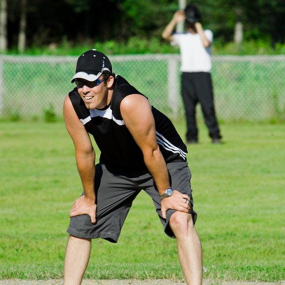 Slow-pitch softball runners must stay on the base until the ball reaches the plate.