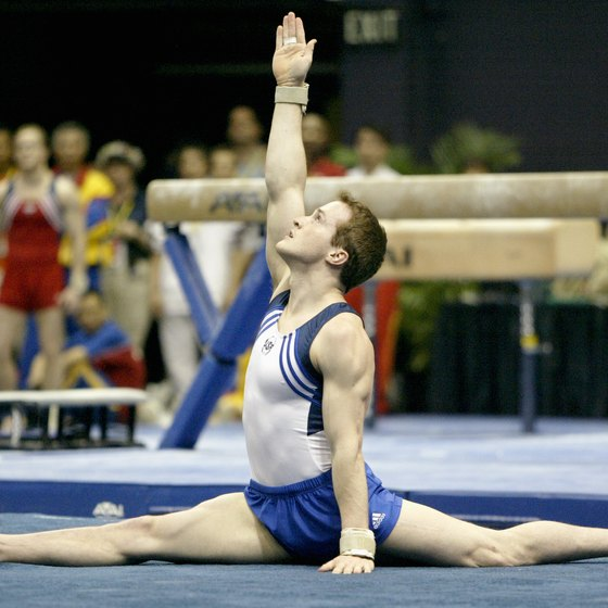 2004 USA Gymnastics national team member Morgan Hamm performs a stride split on the floor.