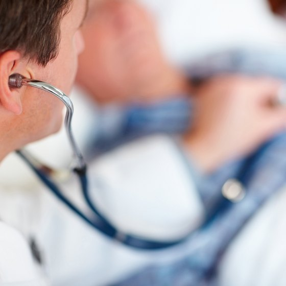 Doctor listening to patient's heartbeat