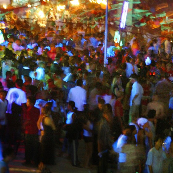 Tourists crowd onto Thailand's beaches at monthly Full Moon Parties.