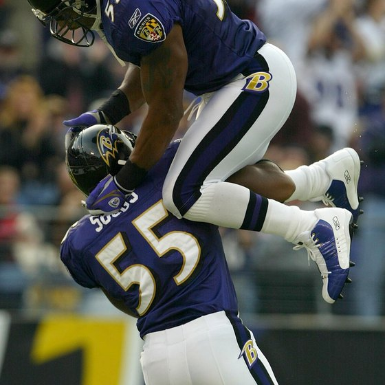 Baltimore Ravens linebacker Terrell Suggs braces for a leaping Ray Lewis.