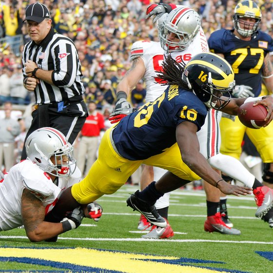 Michigan quarterback Denard Robinson runs for a touchdown against Ohio State in 2011.