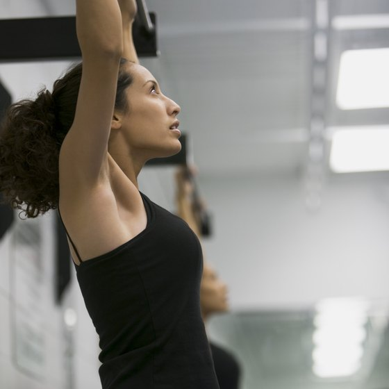Yes, women can perform pullups, too.