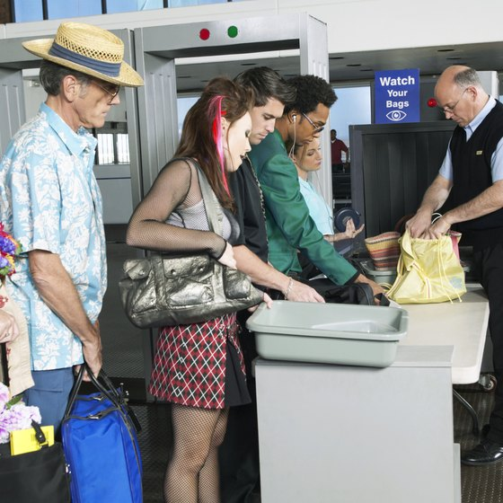 To pass through security quickly, remove items containing metal, like jewelry.