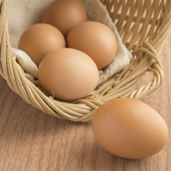 Brown eggs splilling out of a basket.
