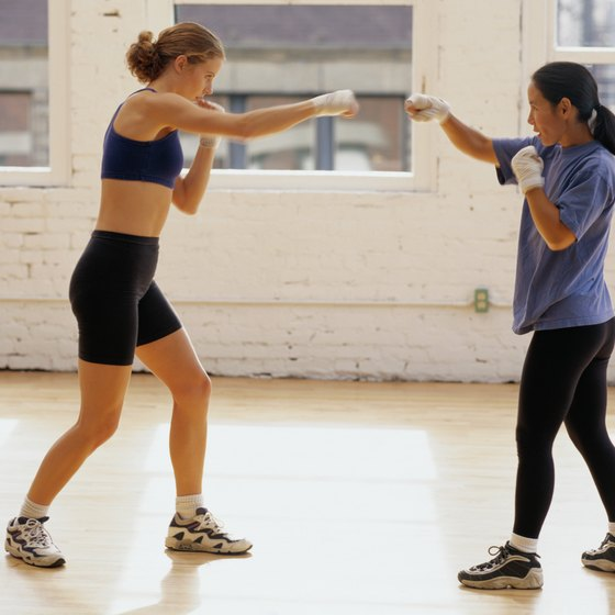 Burn approximately 400 calories during a kickboxing workout.