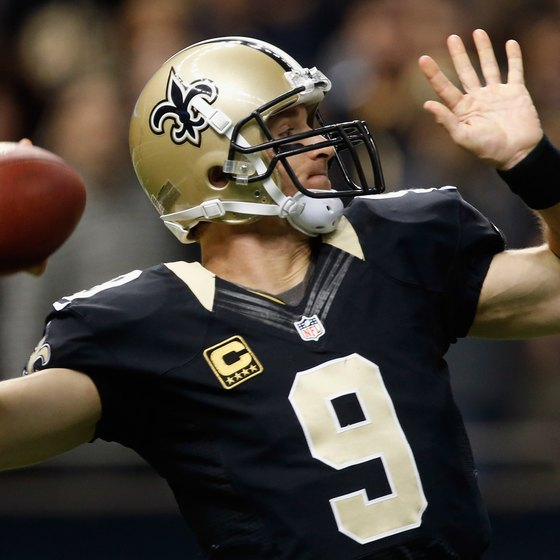 Saints quarterback Drew Brees hurls a pass downfield.