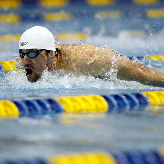 Olympic gold medalist Michael Phelps competes in the butterfly stroke.