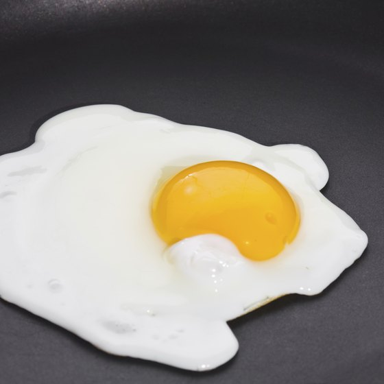 An egg in a fry pan.
