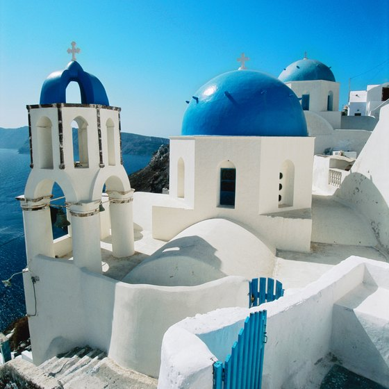 Visitors flock to Santorini to see the stunning white- and blue-domed cliffside churches.