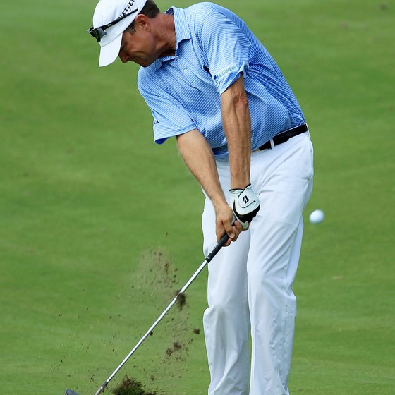 Davis Love III takes a divot after striking the ball during the 2011 PGA Championship.