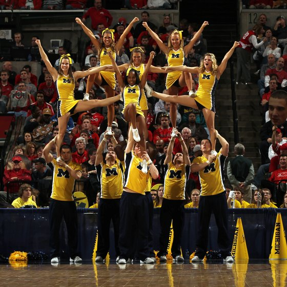 Male cheerleaders are often tasked with supporting their fellow cheerleaders, which requires ample strength.