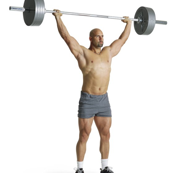 The overhead lift has its roots in old-time muscle man training.