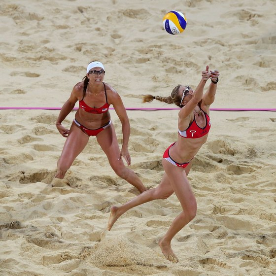 U.S. Olympian Kerri Walsh Jennings leaps for the ball.
