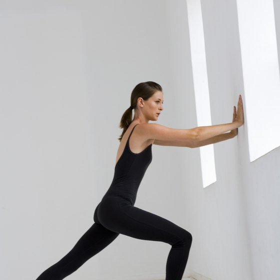 A wall provides an effective way to exercise the stomach muscles.