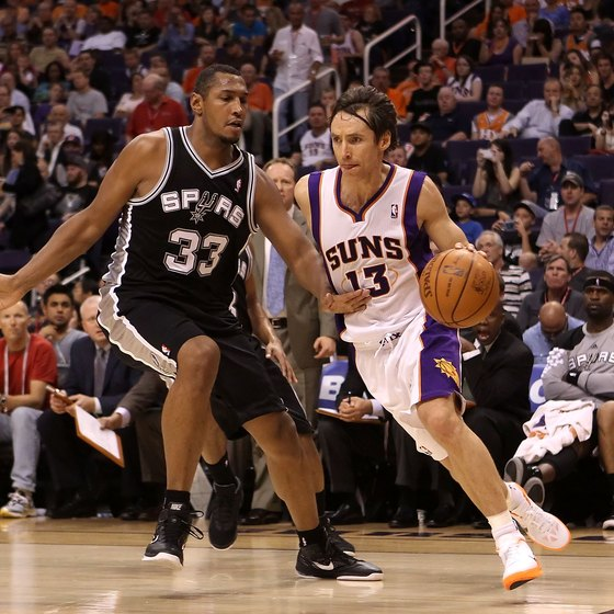 Steve Nash uses strength and quickness to dribble past Boris Diaw.