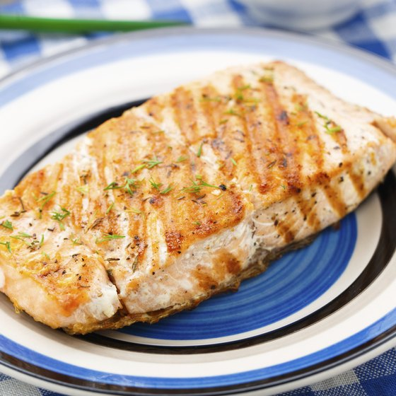 Grilled salmon filet on small dish.