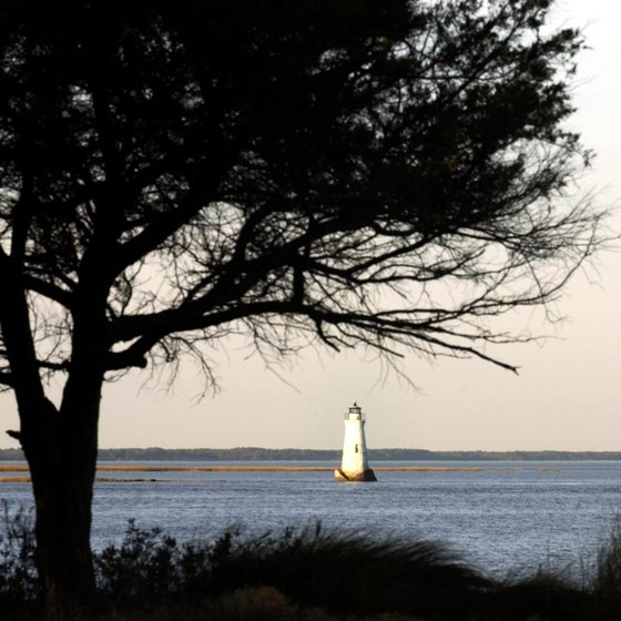 Tybee Island vistas include a lighthouse and salt marshes.