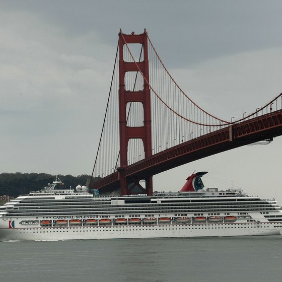 Carnival cruise ship sailing under the Golden Gate Bridge.