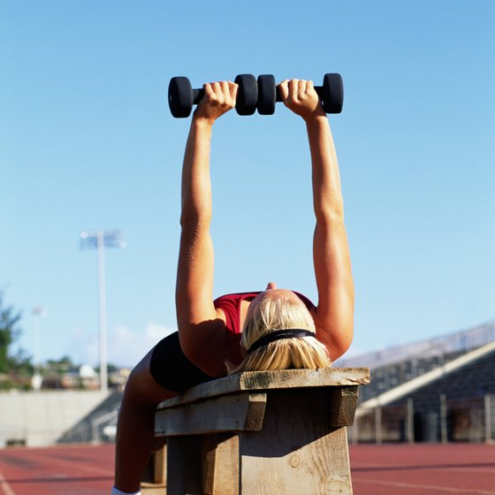 Dumbbell bench presses target the pectoral muscles that support the breasts.