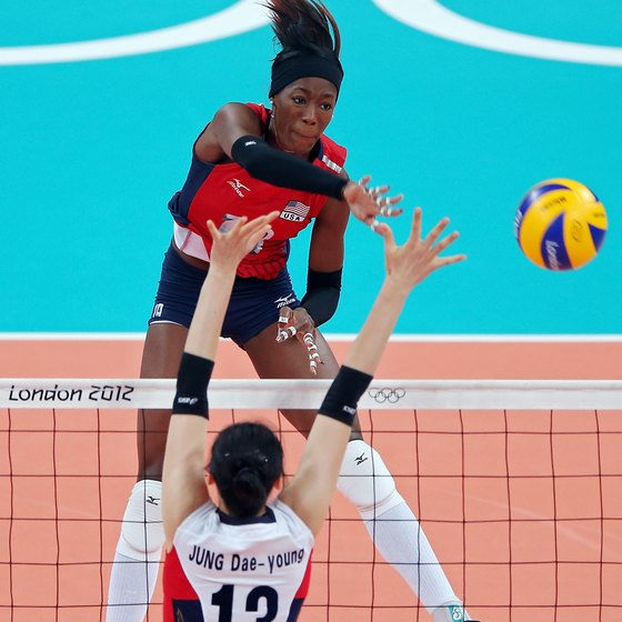 U.S. women's team star Destinee Hooker attacks the ball against Korea.