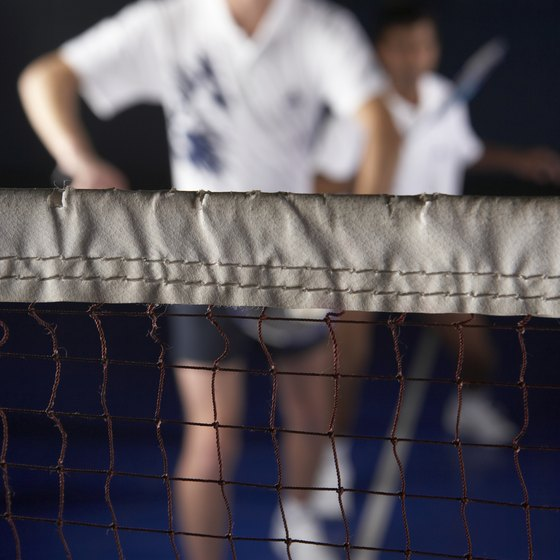 The height of the net is measured in three spots.