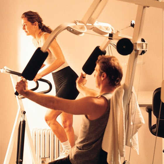 Most gyms provide a machine that allows you to bench press while sitting.