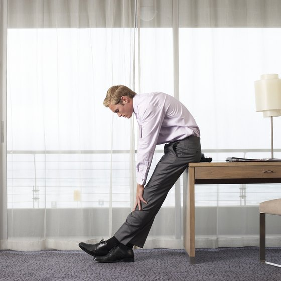 Seated stretches can help you relieve sore hamstrings.