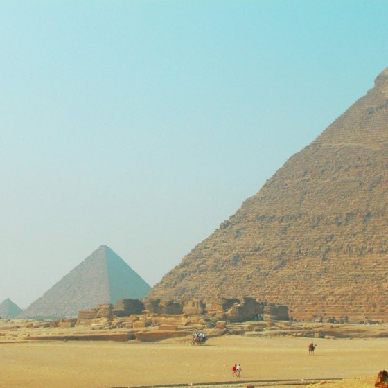 Tourists flock by the thousands to the pyramids at Giza.