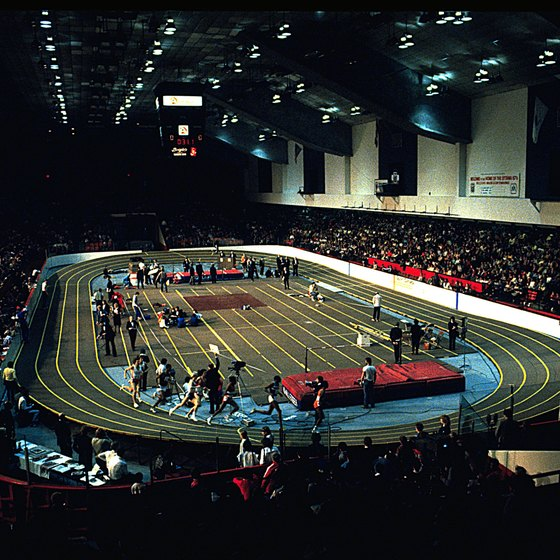 A standard indoor track measures 200 meters, making the mile race eight laps plus nine meters.