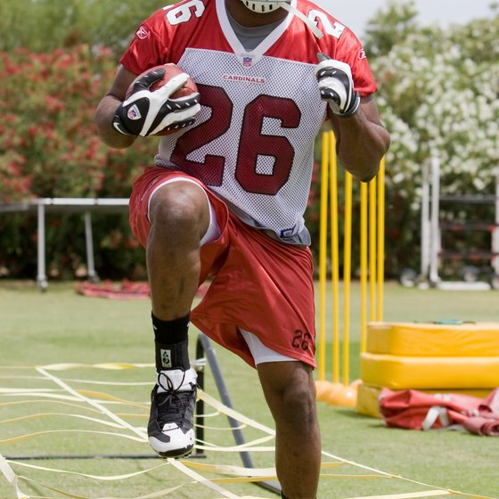 Chris Wells of the Arizona Cardinals works with a high-step agility ladder.