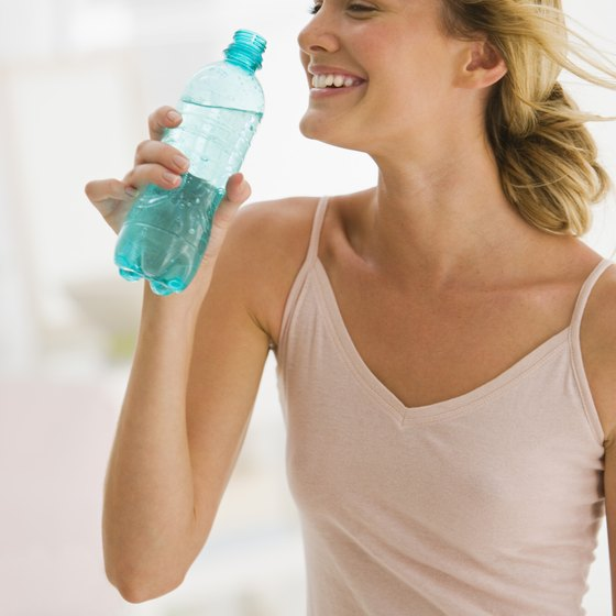 Drinking water can decrease bloating for a flatter belly.