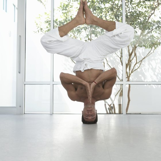 Inversions include all yoga poses that place your feet and heart higher than your head.