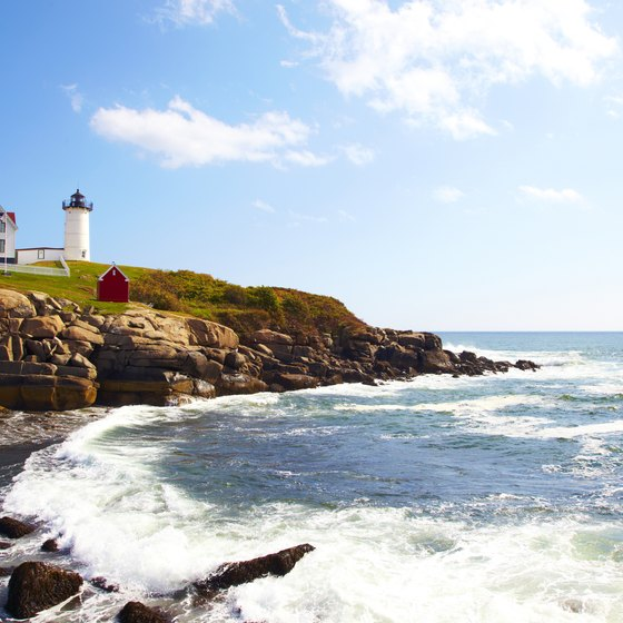 See lighthouses, such as this one at Cape Neddick, Maine, on your cruise.