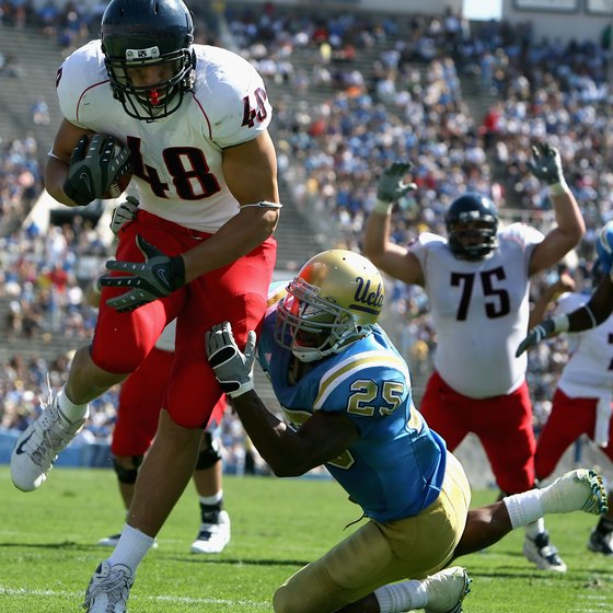 Tight end Rob Gronkowski scores a touchdown for the University of Arizona in 2008.