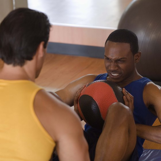 Try doing medicine ball sit-ups with a partner.
