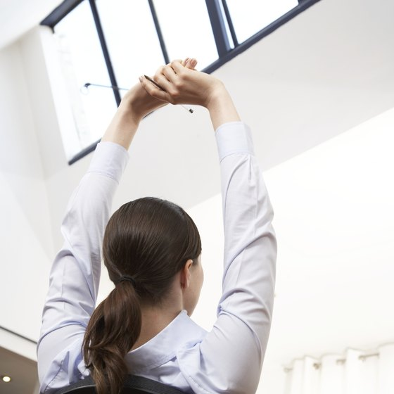 Doing back exercises at your desk can help improve posture and reduce tension.
