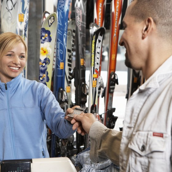 Expenses such as wages reduce your sports store's profit.